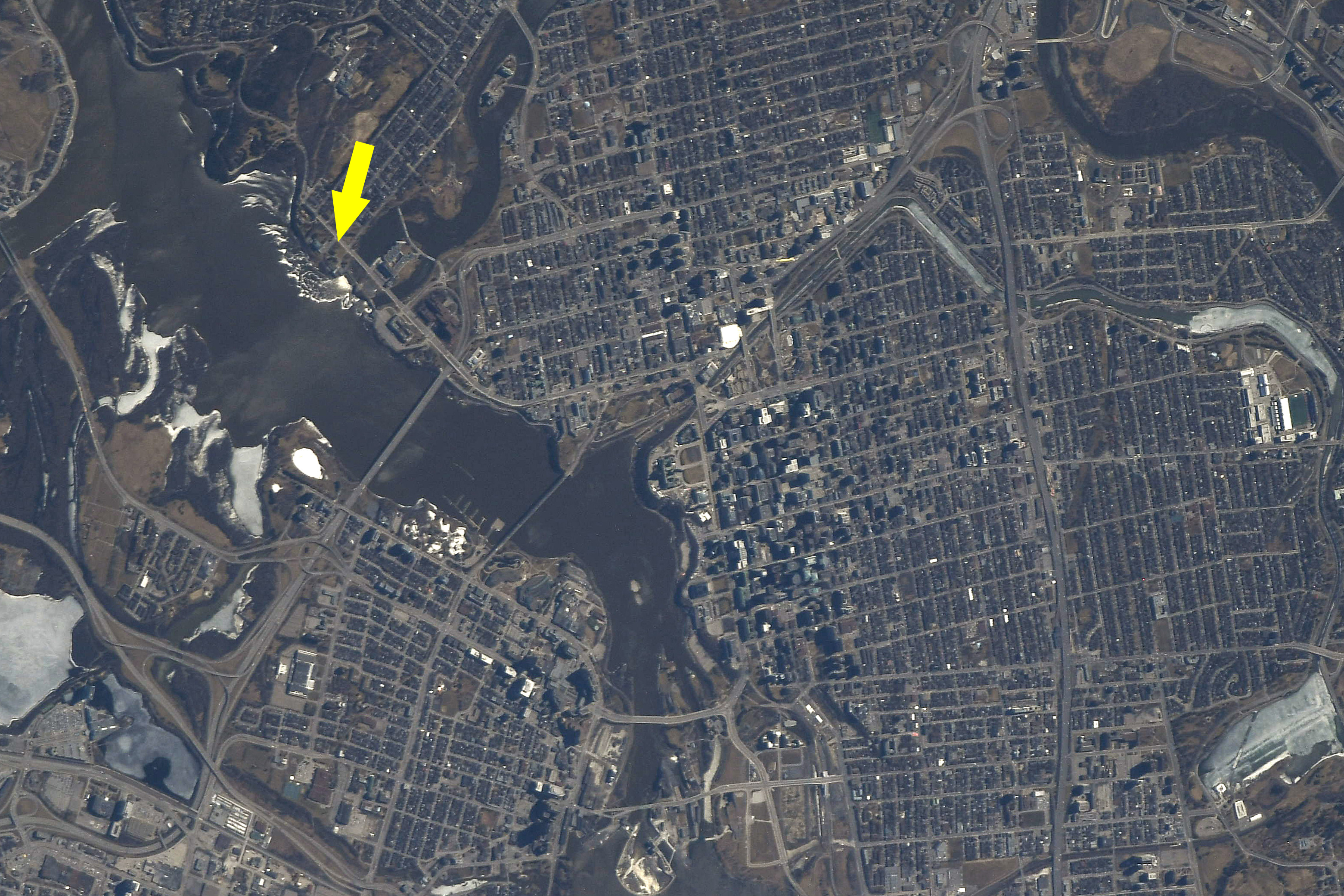 View of Ottawa from orbit with 50 Sussex Drive indicated by a yellow arrow