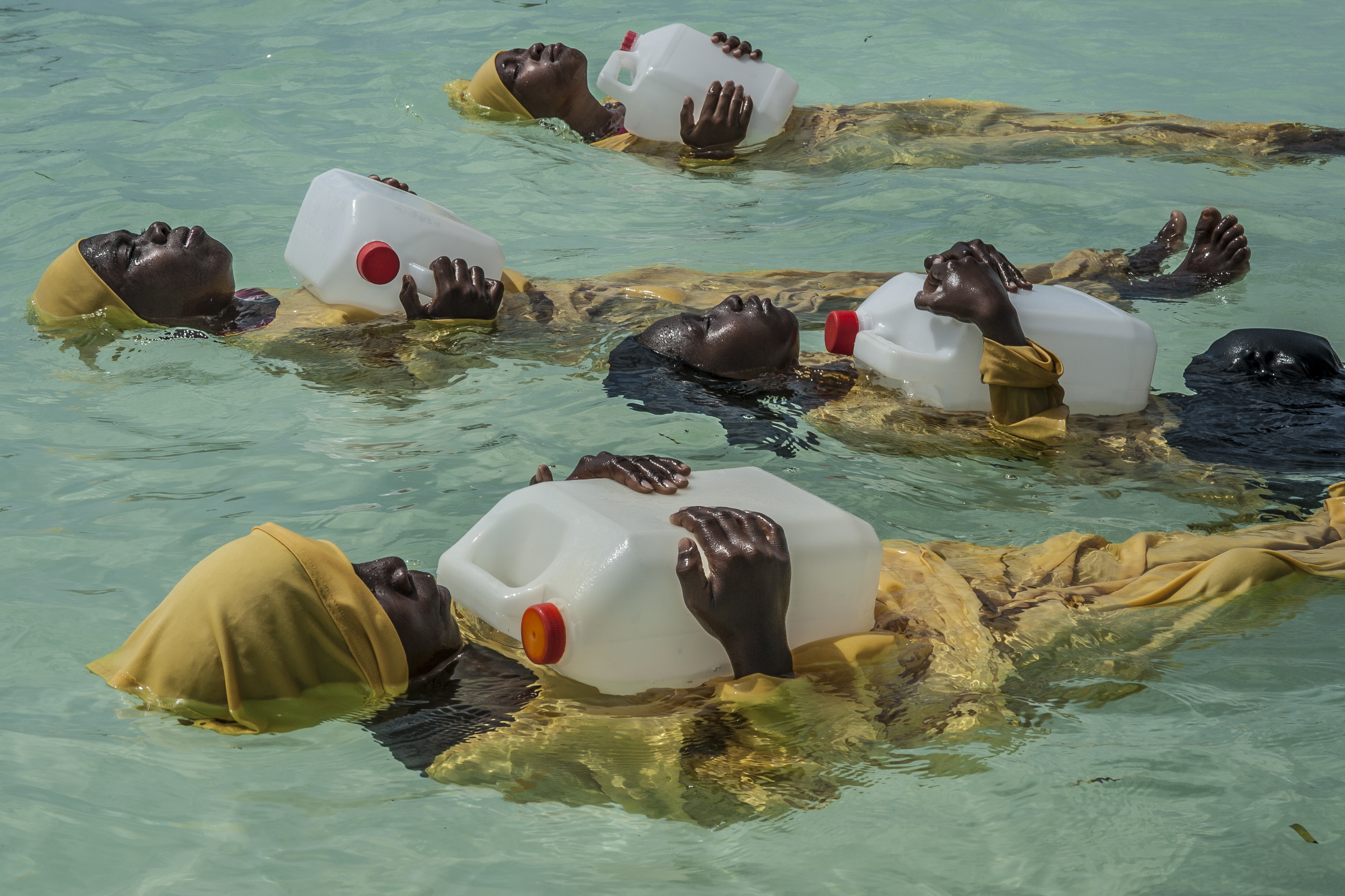 Students from the Kijini Primary School learn to swim and perform rescues, in the Indian Ocean, off Muyuni Beach, Zanzibar.