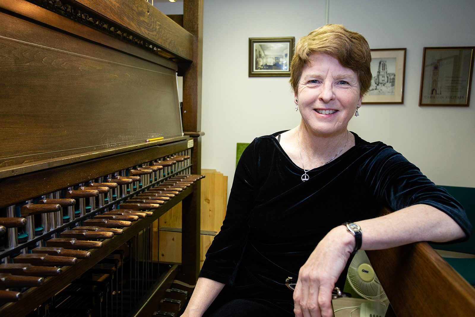Dominion carillonneur Andrea McCrady with the practice keyboard in her office