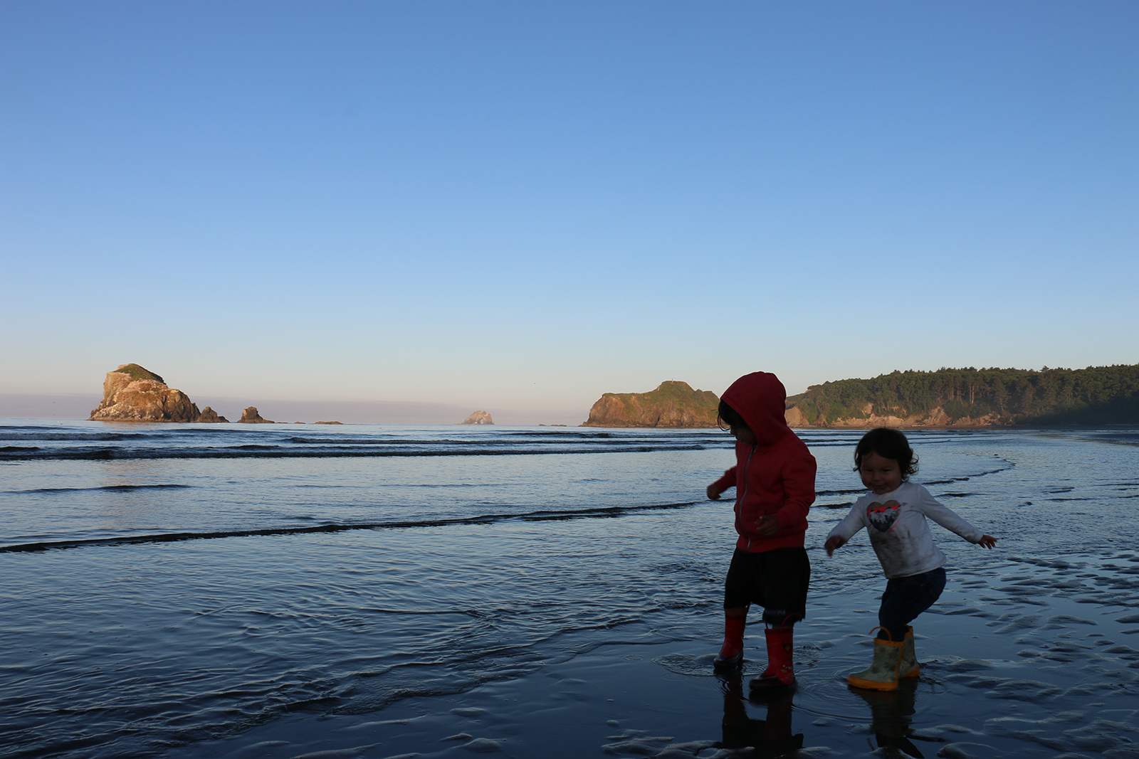 Children play on the beach below Point Grenville on the Quinault reservation.