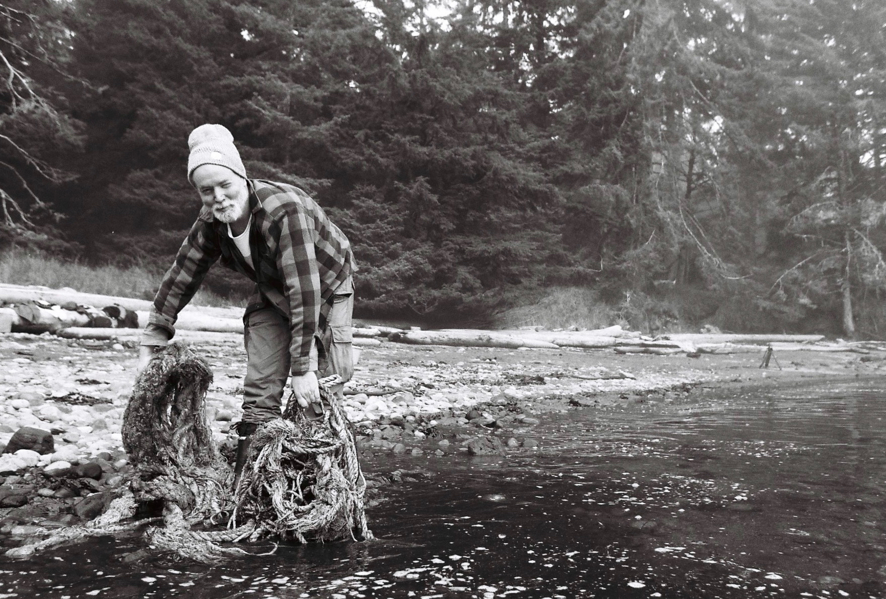artist Douglas Coupland collects discarded fishing rope from a beach in Haida Gwaii
