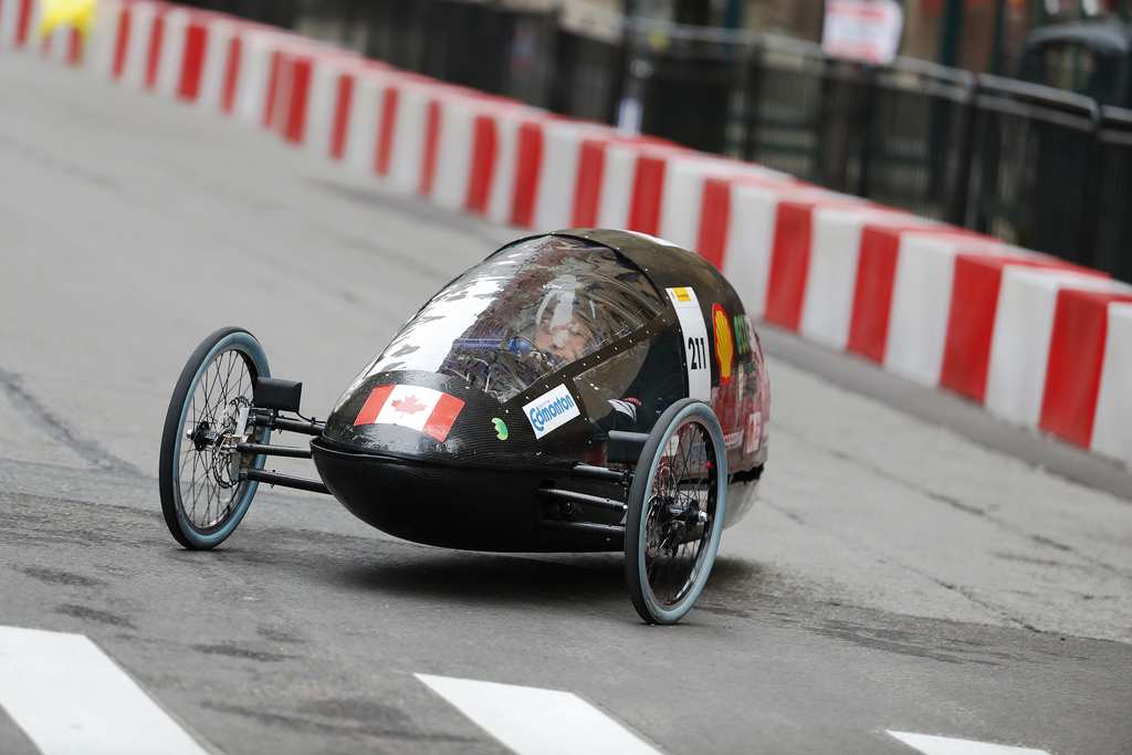 The University of Alberta's Ualberta EcoCar team hydrogen prototype vehicle driving on the track.