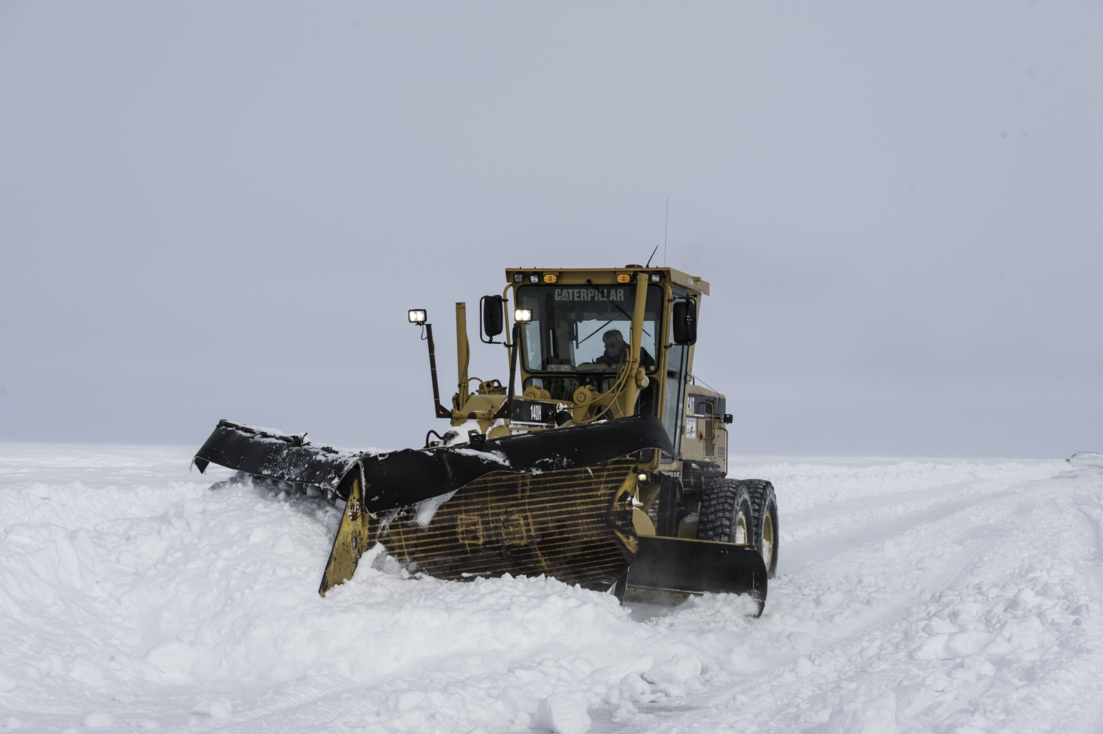 A snowplow clears the ice road between Tuktoyaktuk and Inuvik