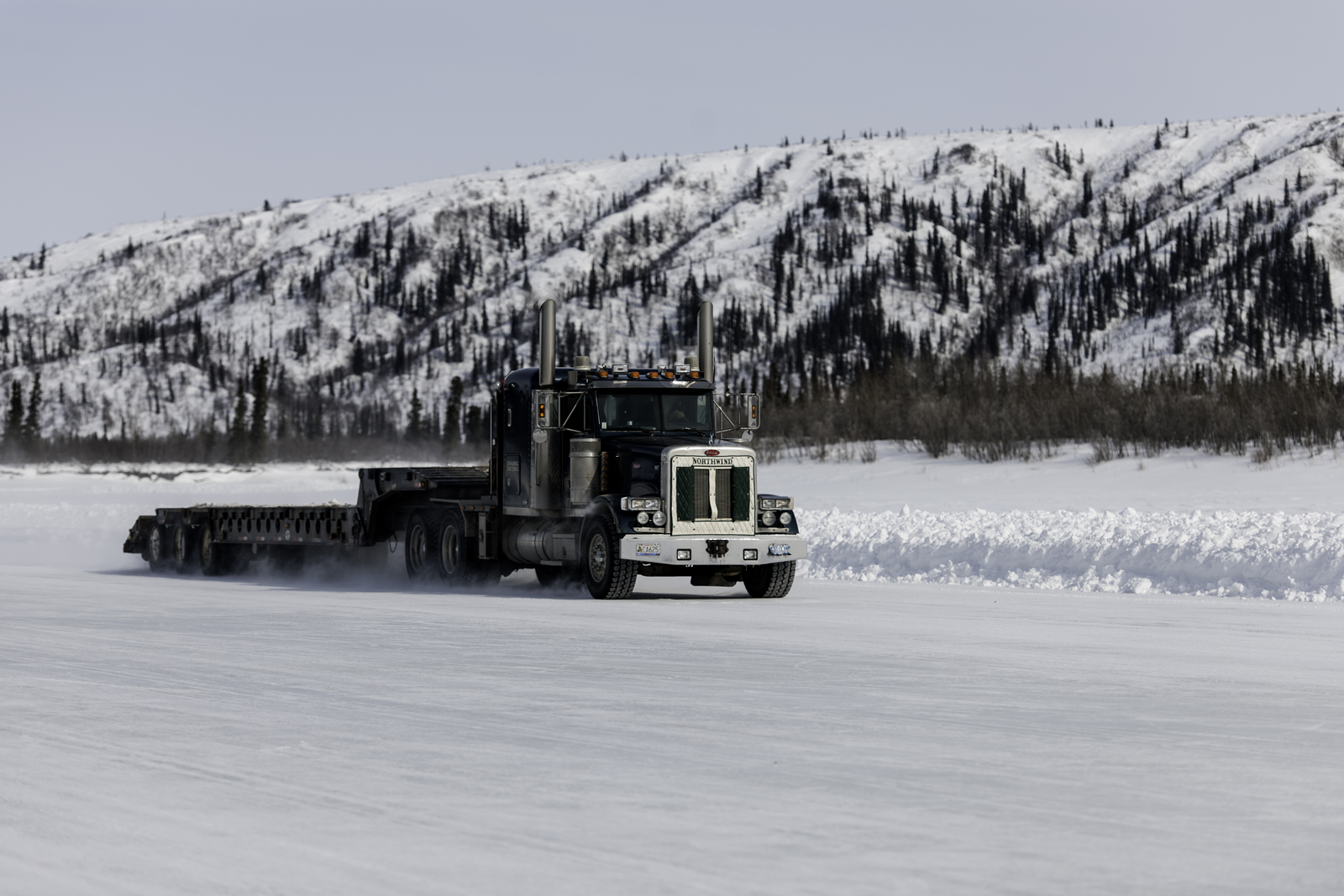 A truck drives on the ice road between Inuvik and Tuktoyaktuk, NWT
