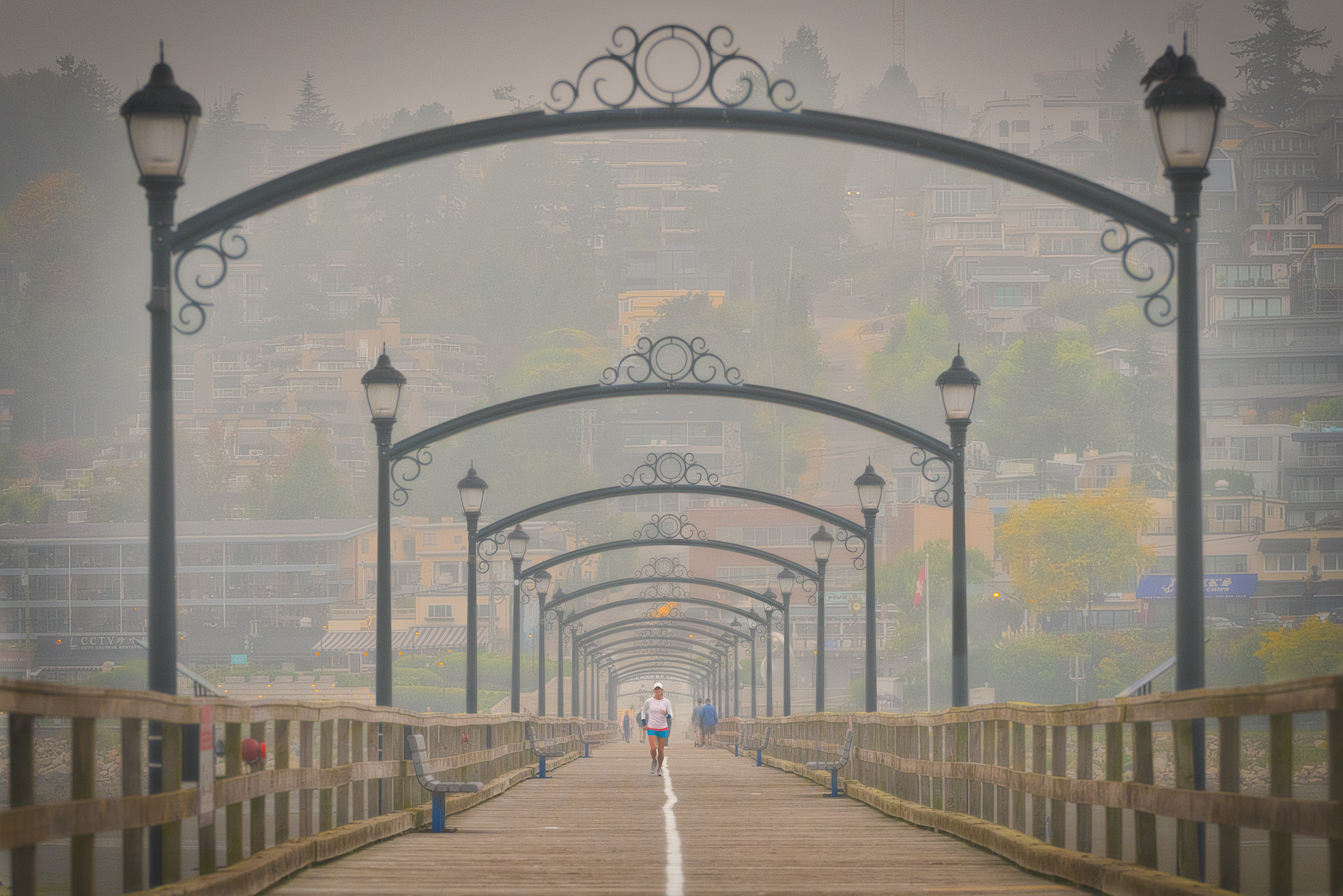 Smoke covers a boardwalk and its archways overhead