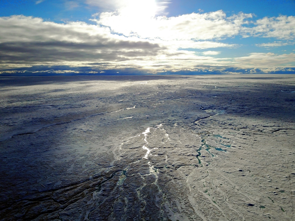 An aerial shot of Greenland's vast ice sheet.