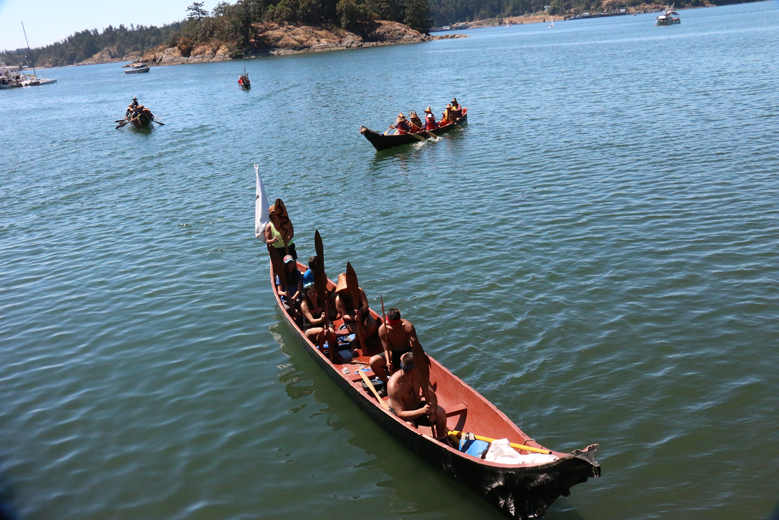 Canoes representing First Nations from Vancouver Island and tribes from the United States arrive in Plumper Bay, Esquimalt and Songhees traditional territory.