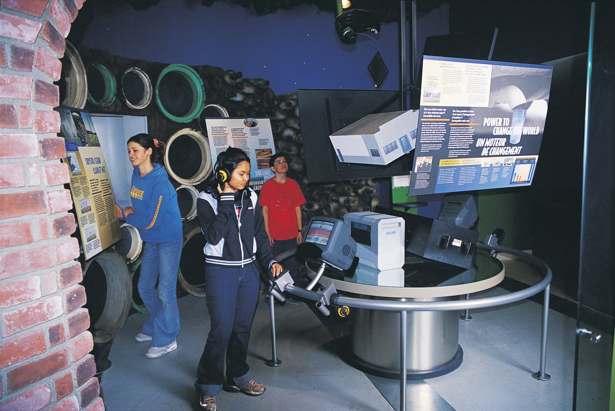 Visitors explore an exhibit at the Canada and the World Pavilion