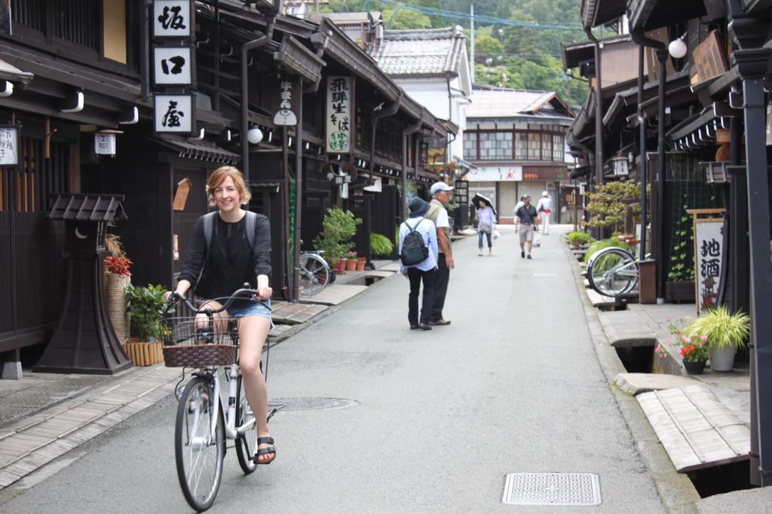 Cycling through Sanmachi Sugi, Takayama's historic merchant district