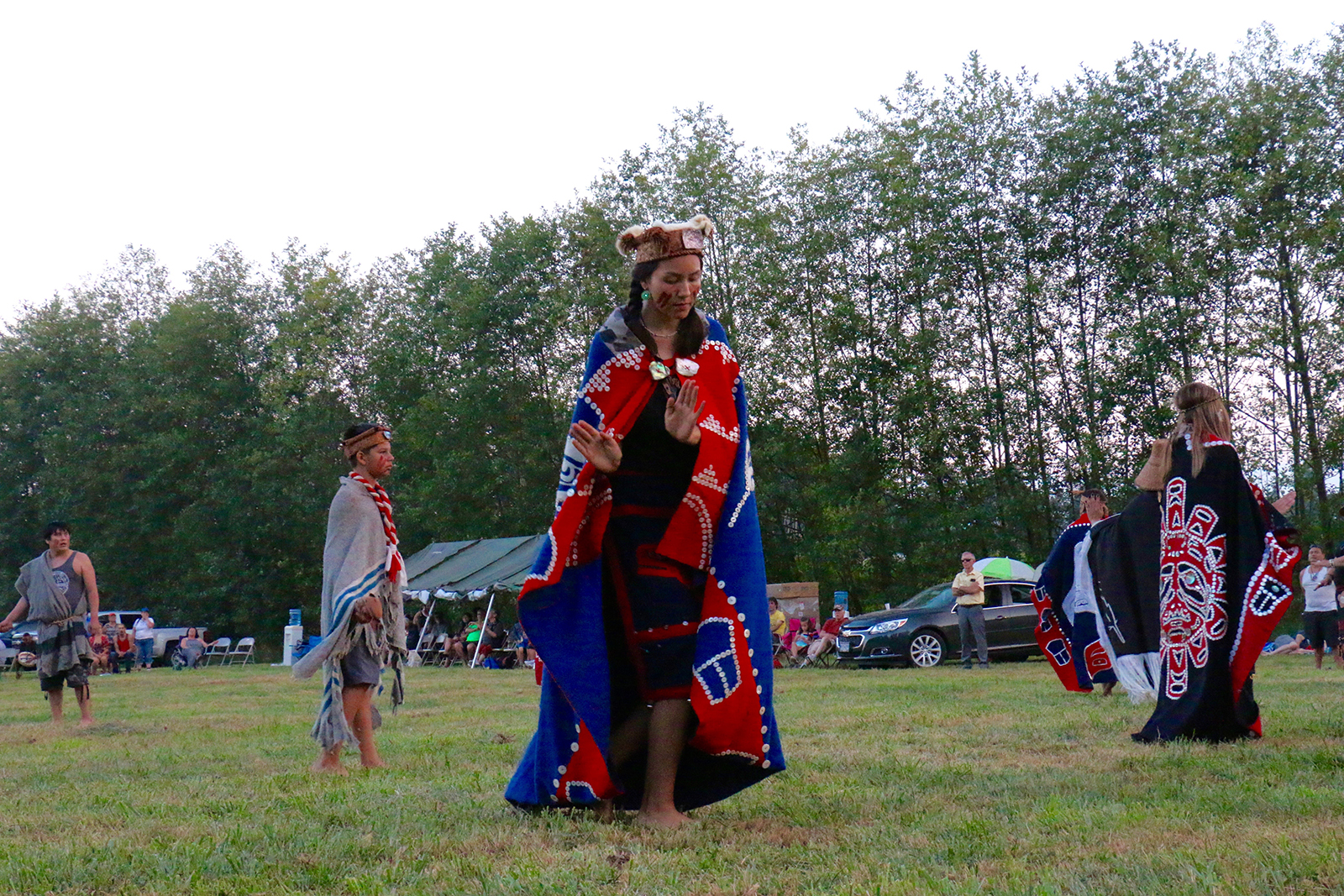 Emma Frank and K'omoks dancers welcome canoe families into their territories with song and dance.