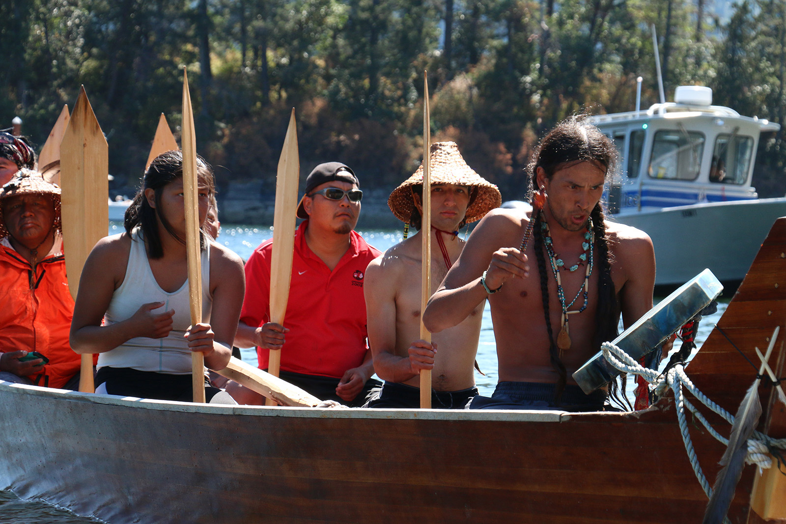 The Quinault crew sings a spirited paddle song as they arrive on Stz'uminus shores.