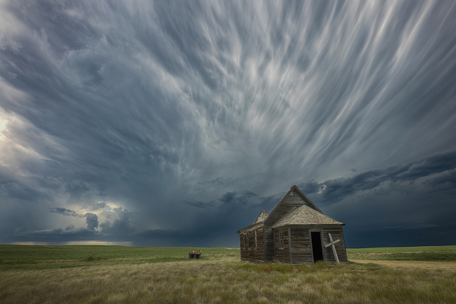 Thunderstorm clouds behind an abandoned church near Leader, Sask. by Ryan Wunsch