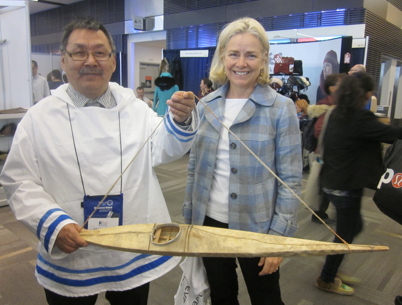 Johannes Lampe, President of the Nunatsiavut Government, and Rozanne Junker with Renatus' kayak