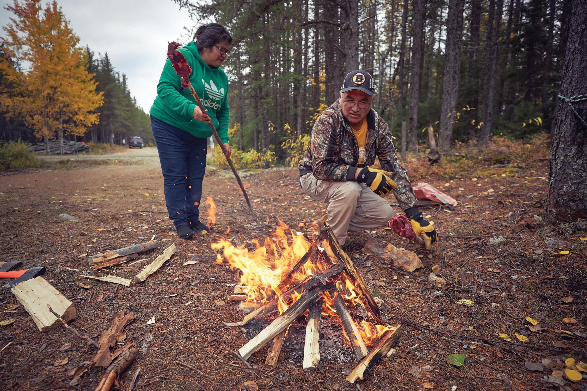 Roasting moose steaks on an open fire