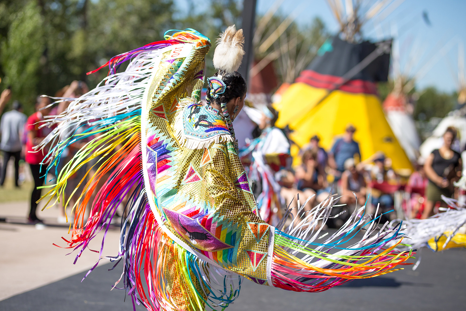 A fancy dancer performs in the Indian Village at the 2017 Calgary Stampede.