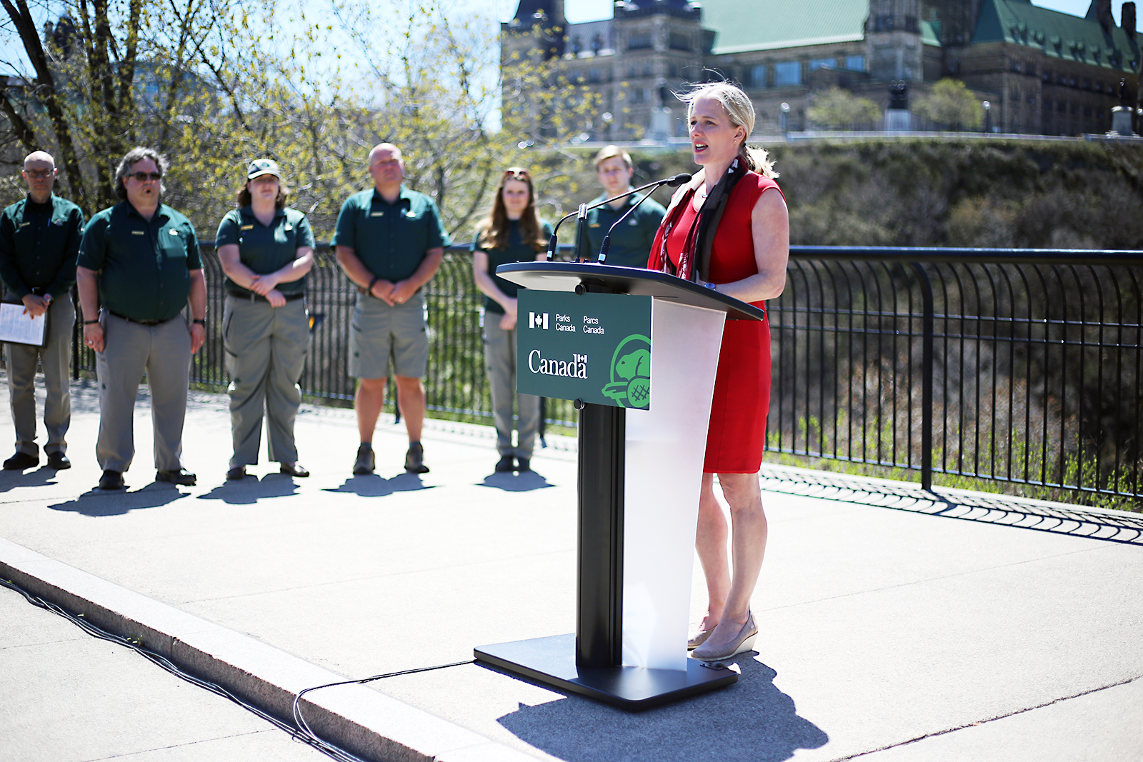 Parks Canada staff look on as Catherine McKenna announces the report on the Minister's Roundtable on Parks at Major's Hill Park in Ottawa.