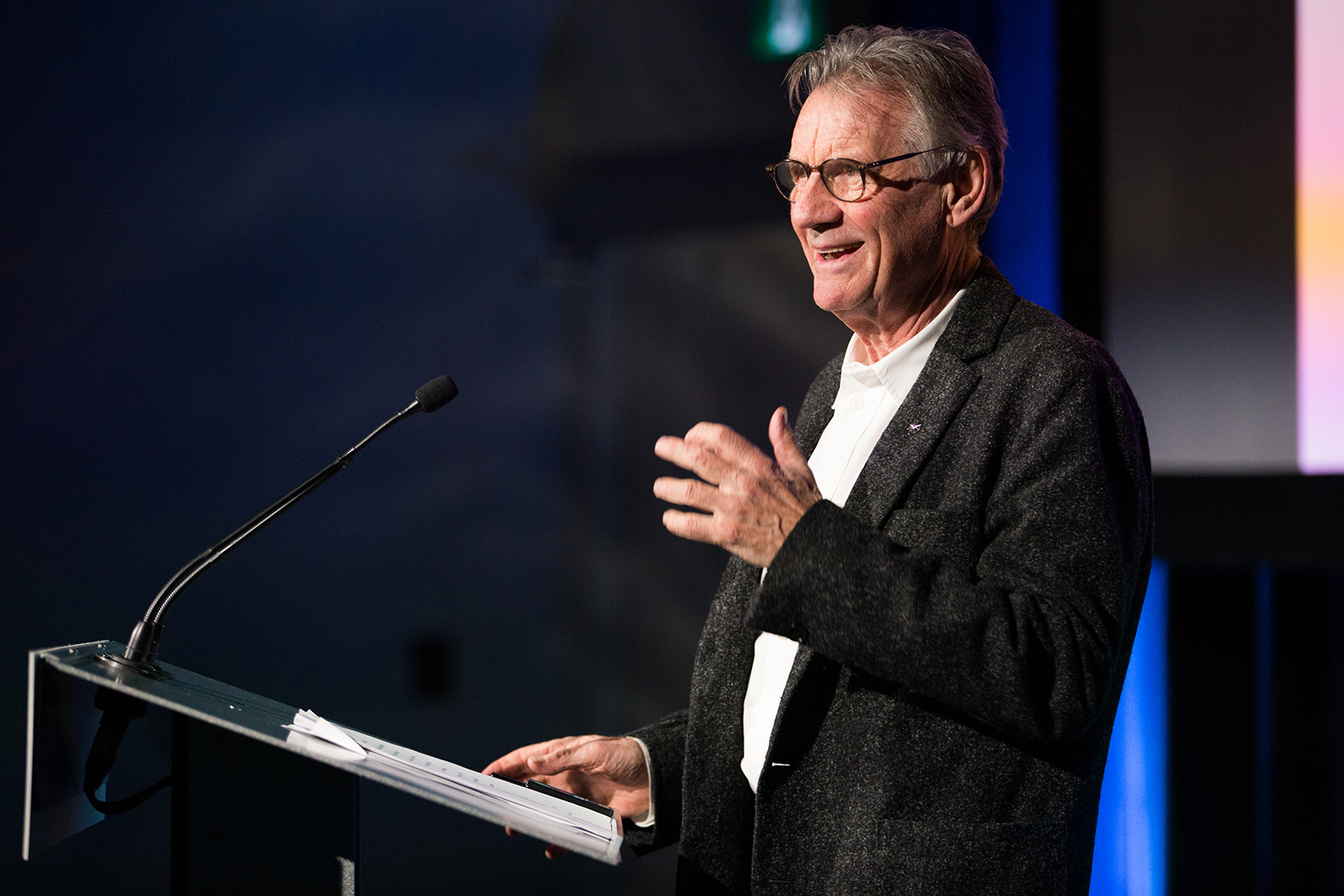 Michael Palin, of Monty Python fame, laughs while giving a talk at 50 Sussex Drive