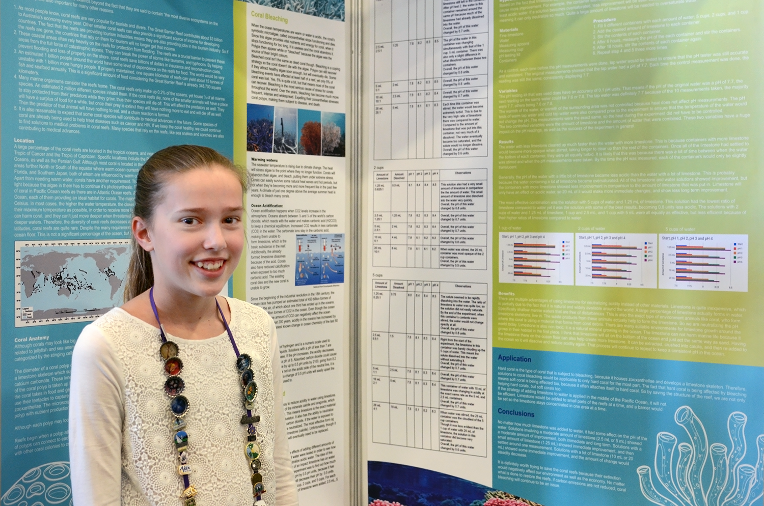 Nikki Van Schaik with her project on coral bleaching