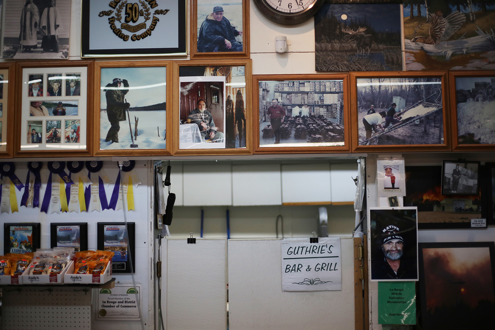 Every inch of available wall space inside Robertson Trading Co. is taken up by photos of trappers and customers