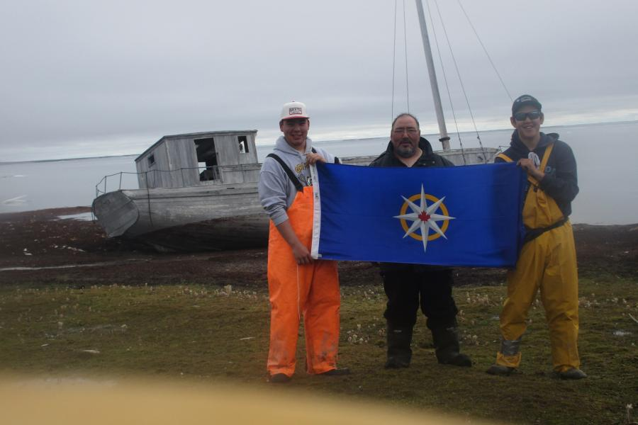 The members of the Humahuk expedition with the remains of an HBC supply boat