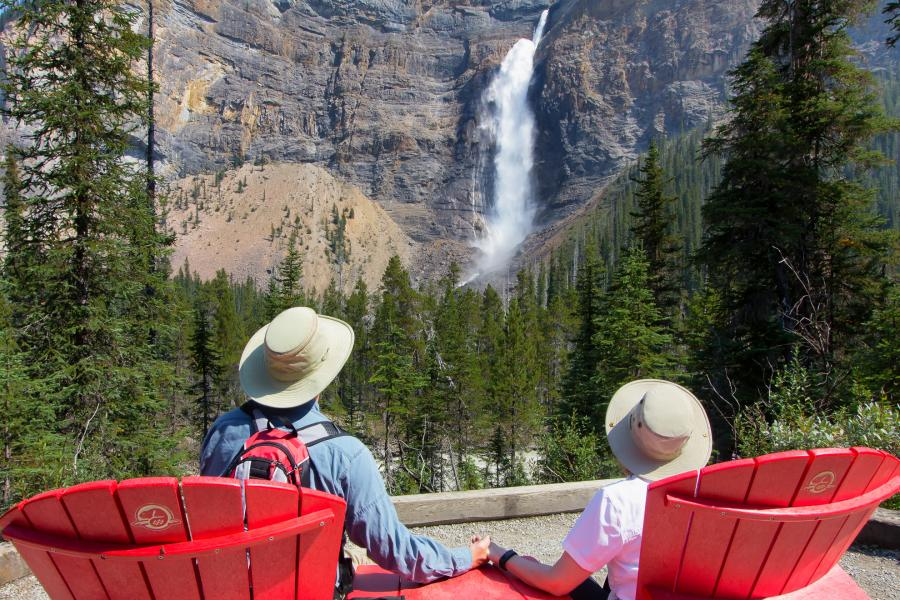 couple observes a waterfall in Yoho National Park