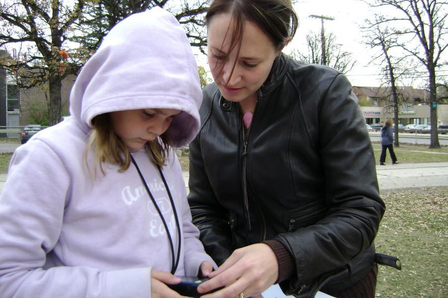 Winnipeg teacher showing her students how to use GPS