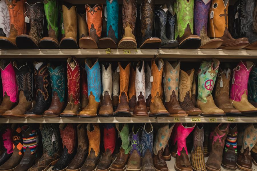 Colourful cowboy boots displayed on shelves in Amarillo Texas by Zach Baranowski