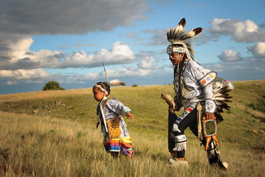 a prairie chicken dancer and his daughter at Wanuskewin Heritage Park