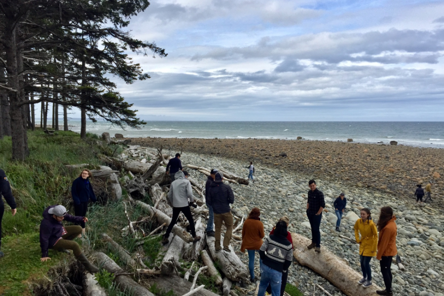 The 2018 Ocean Bridge cohort gets to know each other during their first steps on a Haida Gwaii beach.