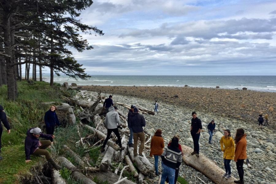 The 2018 Ocean Bridge cohort gets to know each other during their first steps on a Haida Gwaii beach.