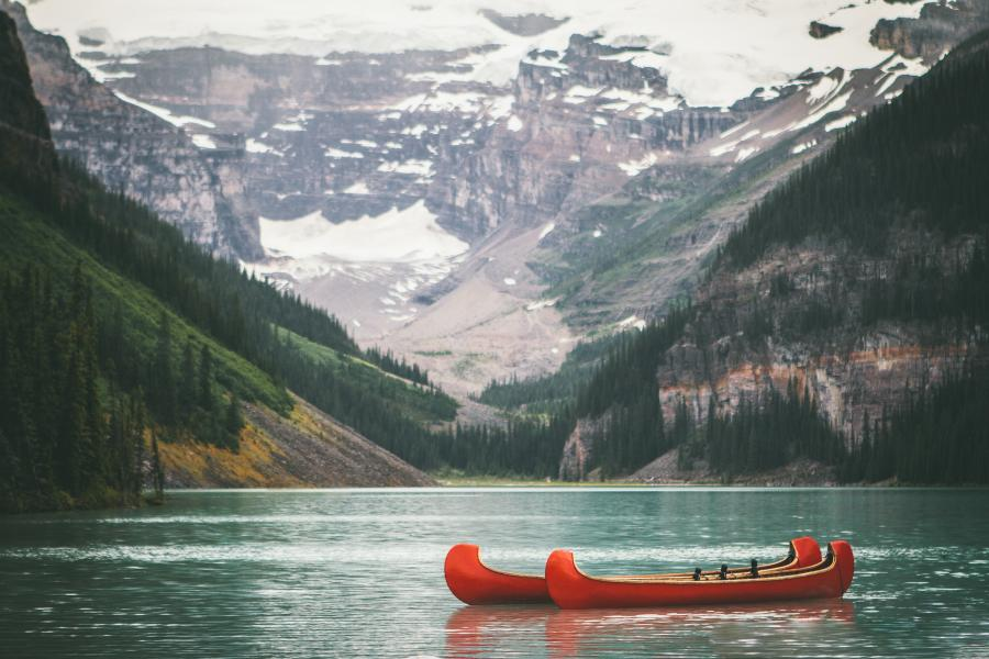 canoes on a lake in canada