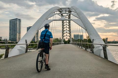 Cyclist prepares to cross bridge