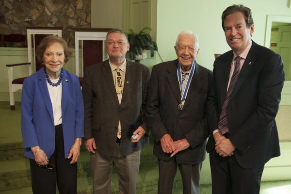 Rosalynn Carter, Arthur Milnes, former U.S. President Jimmy Carter, and RCGS CEO John Geiger
