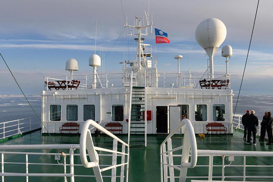 The Royal Canadian Geographical Society's 2014 Victoria Strait Expedition flag flies above the One Ocean Voyager