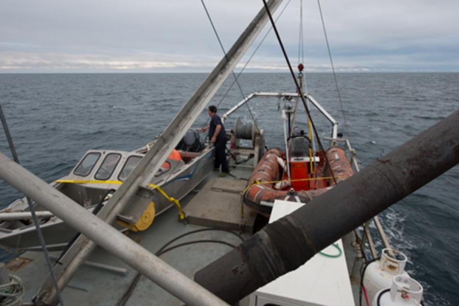 A crew member on the Martin Bergmann prepares as the ship sails off on the Victoria Strait Expedition last month