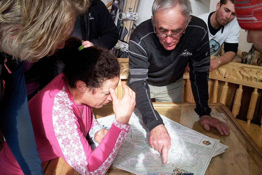 Rudi Gertsch shows clients where they had just gone skiing