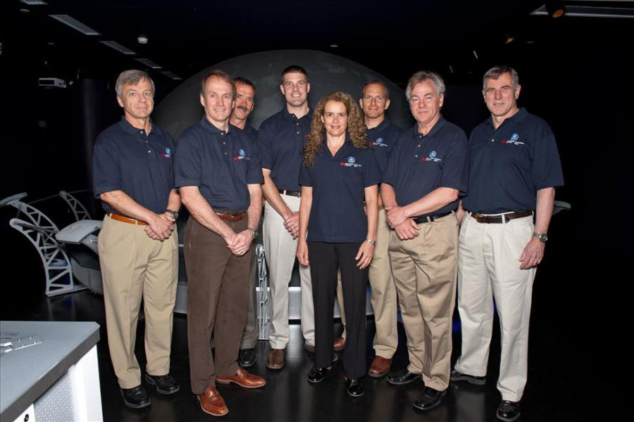 Canadian astronauts pose inside the Living in Space Exhibition
