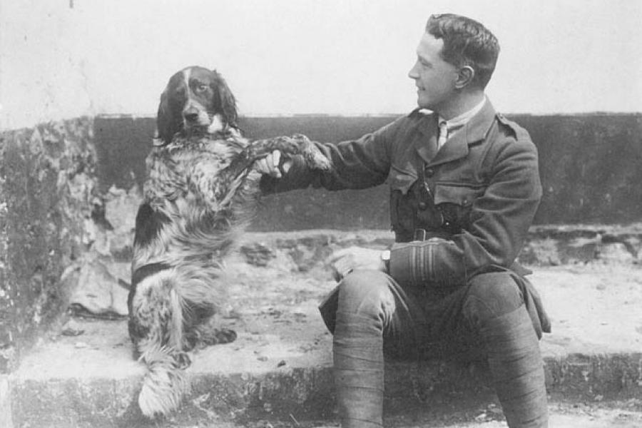 John McCrae, writer of the poem 'In Flanders Fields,' sits with his dog Bonneau circa 1914.