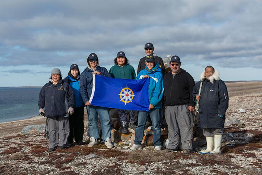 Louie Kamookak stands with the students and elders participating in the 2015 Malerualik Expedition