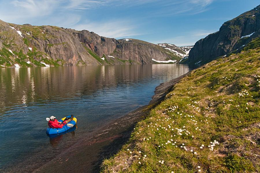 Granite hills surrounding an inland fiord lake in Labrador's English Mountains. Blackflies diminish on the water, making rafting a good way to explore the shoreline. (Photo: Jerry Kobalenko)