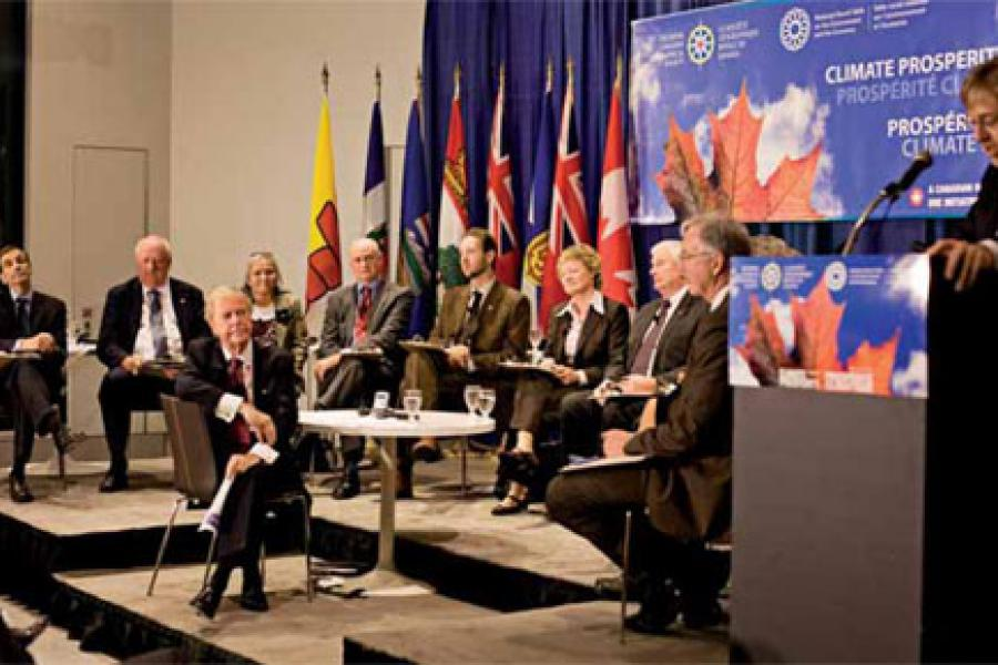 NRTEE's David McLaughlin (ABOVE, at right) introduces 11 panellists of a round-table discussion on climate change. The panel in Ottawa was moderated by former CBC broadcaster Don Newman (ABOVE, centre). (Photo: Devin Jeffrey)