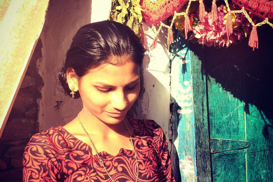 A member of the Mahila Samakhya program outside her home.