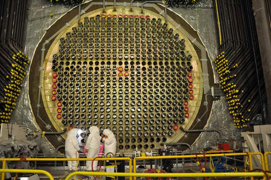 Nuclear workers at the calandria (which houses the fuel) of a Bruce Power reactor.