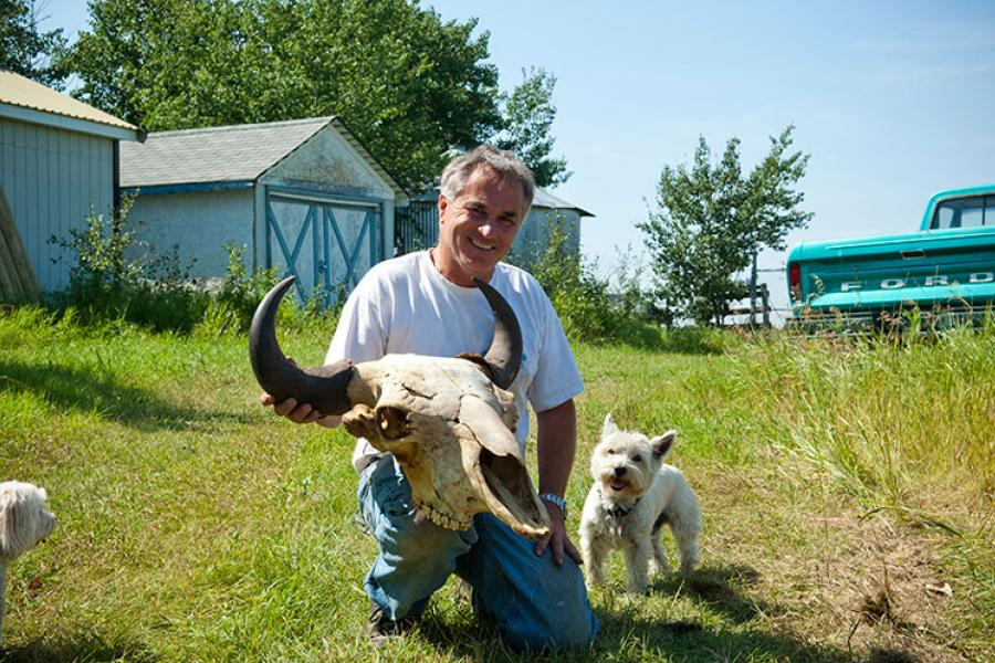 Barry Kaye holds a bison skull at his ranch near Wainwright, Alta.