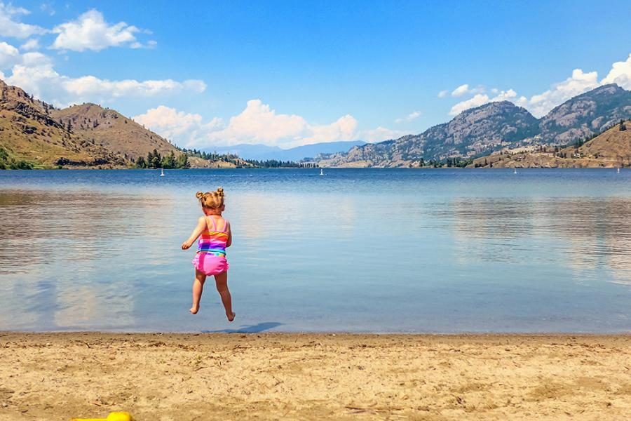 Child jumping into Skaha Lake, British Columbia