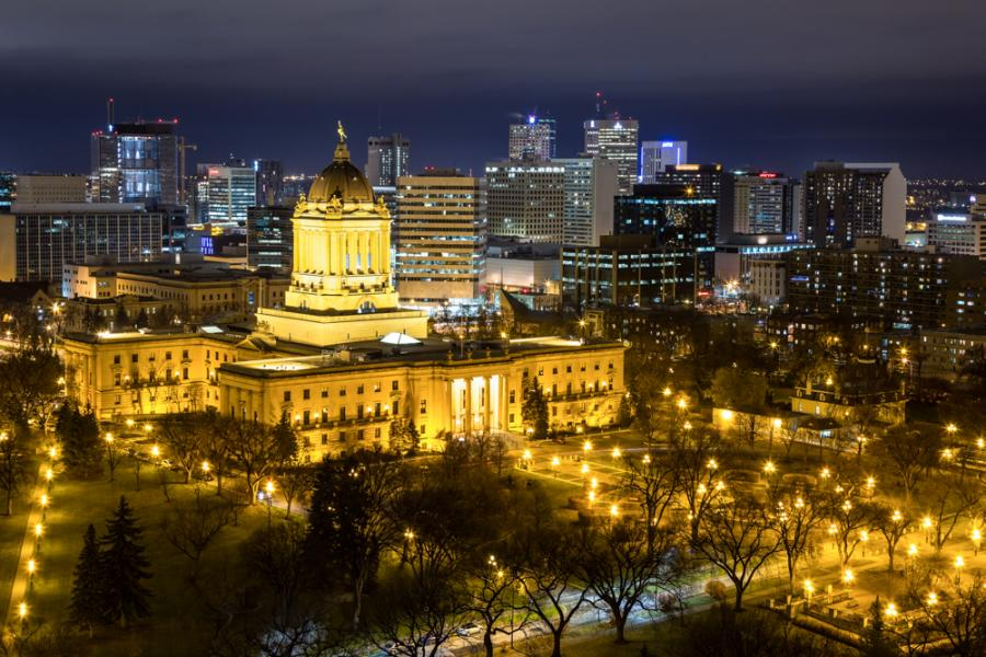 Nighttime view of downtown Winnipeg with Manitoba legislature front and centre