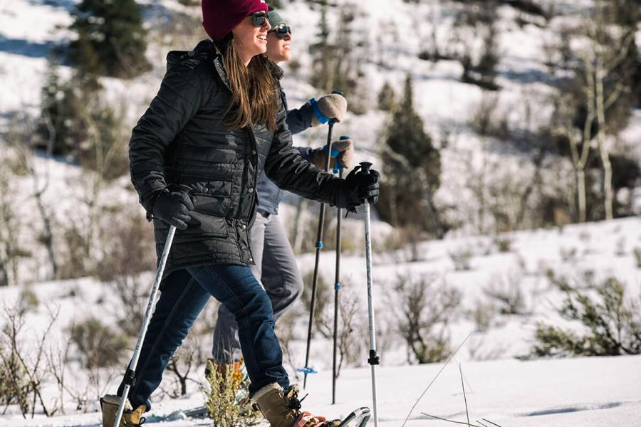 Woman cross-country skiing in the Carhartt women's Amoret Quilted Coat
