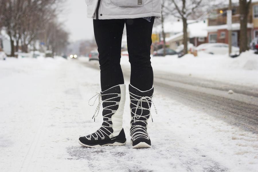 Woman wearing winter boots on a snowy street