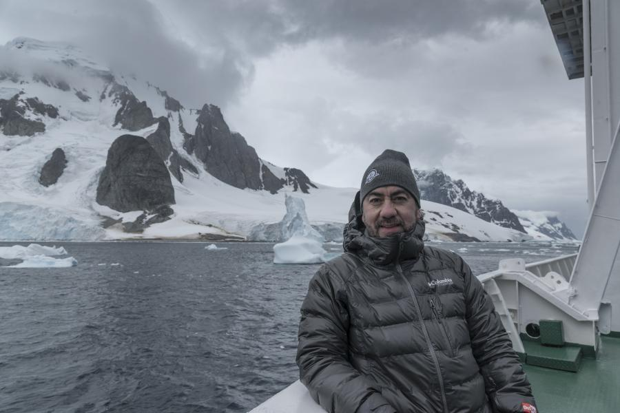 Javier Frutos wears Columbia jacket on ship