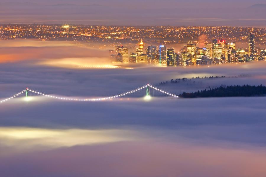 Downtown Vancouver and Burrard Inlet are immersed in fog on an autumn evening. (Photo: June Szasz)